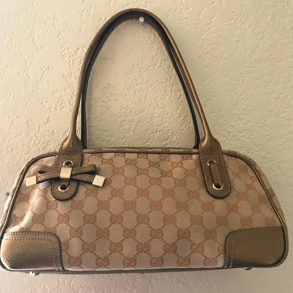 820befbd438 Gucci Handbags - Gucci Gold GG Canvas Princy Boston Bag